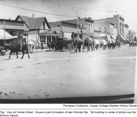 View on Center Street. House is part of location of later Wonder Bar. Tall building in center of photo was the Elkhorn Saloon. Thompson/Bryant Collection, Casper College Western History Center