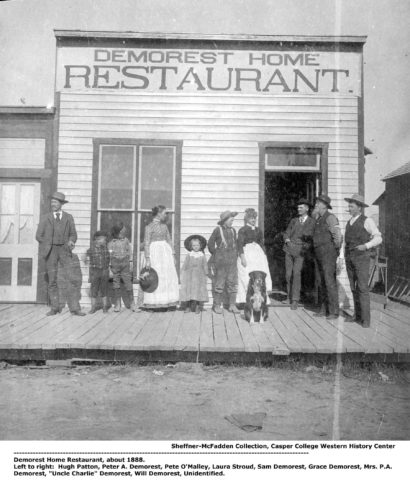 "Demorest Home Restaurant, about 1888. Left to right: Hugh Patton, Peter A. Demorest, Pete O'Malley, Laura Stroud, Sam Demorest, Grace Demorest, Mrs. P.A. Demorest, ""Uncle Charlie"" Demorest, Will Demorest, Unidentified. Sheffner-McFadden Collection. Casper College Western History Center."