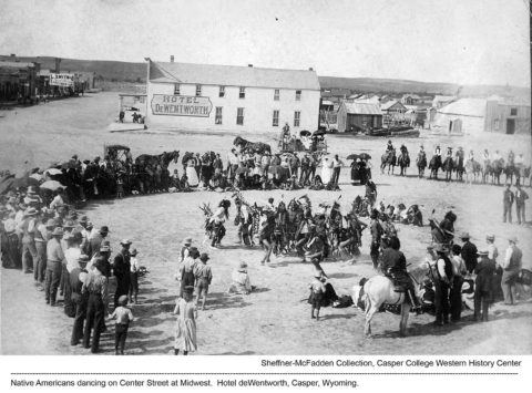 Native Americans dancing on Center Street at Midwest. Hotel deWentworth, Casper, Wyoming. Sheffner-McFadden Collection. Casper College Western History Center.