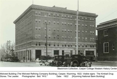 "Midwest Building (The Midwest Refining Company Building), Casper, Wyoming, 1922. Visible signs: The Kimball Drug Stores. The Leader. Photographer: Bell. ""#10."" Date: 1922, Wyoming National Bank Building"